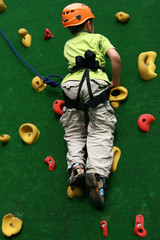 Boy on climbing wall
