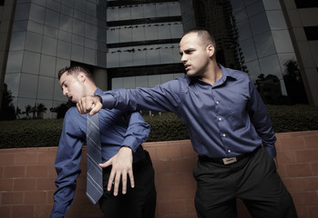 Businessman punching the other businessman