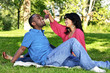 Happy couple having picnic in park
