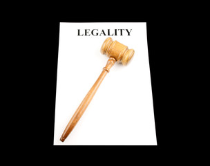Gavel on white paper isolated on black