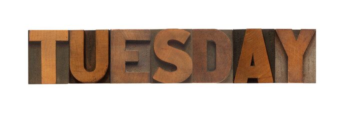 the word Tuesday in old wood type
