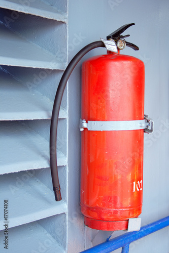 Fire extinguisher on the grey wall