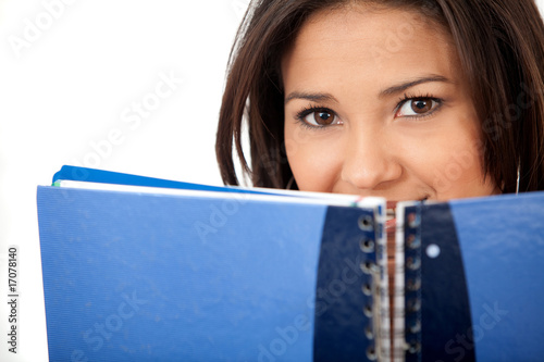 Woman covering with a notebook
