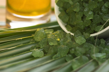 bath salt, oil and palm leaf