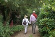 couple walking on a path and holding hands