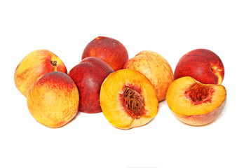 Peaches and sections isolated on white background