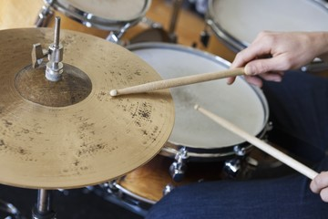 Caucasian man plays drum set