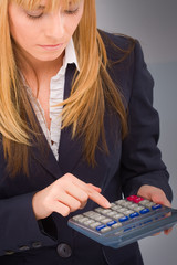 Business woman use calculator