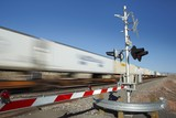Train passing level crossing, motion blur