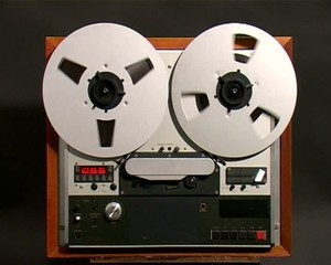Open Reel tape recorder reels spinning
