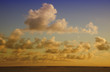Cumulus Clouds above South Pacific Ocean at Sunset