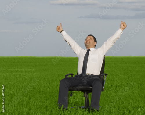 businessman take energy from nature in the meadow with dark blue