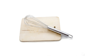 Whisk on a board