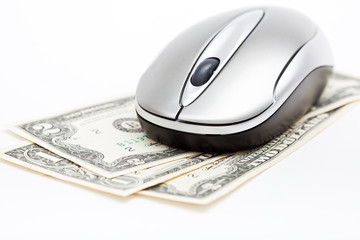 Computer mouse on dollars