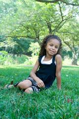 A beautiful mixed race child enjoying the outdoors