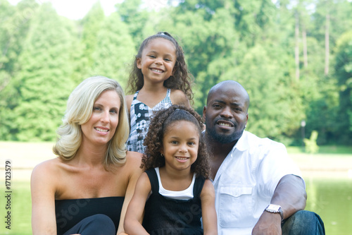 A loving mixed race family enjoying the park