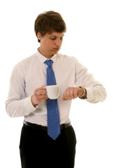 Young businessman is looking at his watch