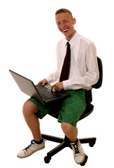 Young funny business man using laptop