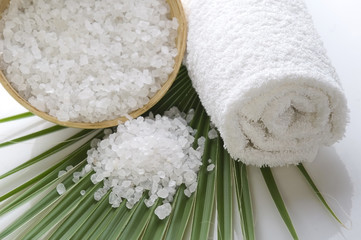 bath salt and palm leaf