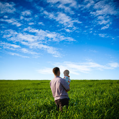 father and son on green field