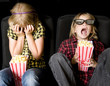 Two Kids at a Scary 3-D Movie - 17142331