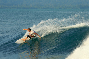 Surfer doing carving on wave, Mentawai Islands, Indonesia