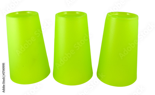 three upside down green plastic cups isolated on white