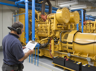 Maintenance contractor checking diesel generators