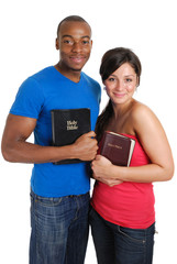 Student couple holding bibles
