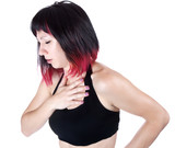expressive portrait of woman who has chest pain