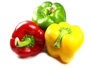 colored peppers on white background