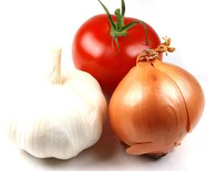 garlic, onion and tomatoe on white background