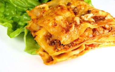 delicious lasagne with salad