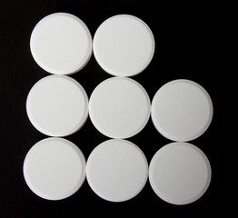 abstract logo of white tablets