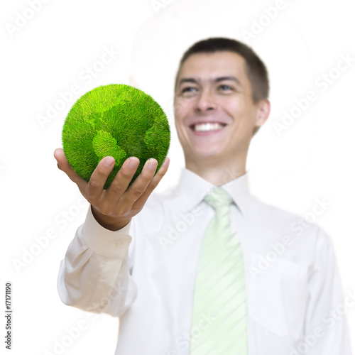 Happy man holding green planet