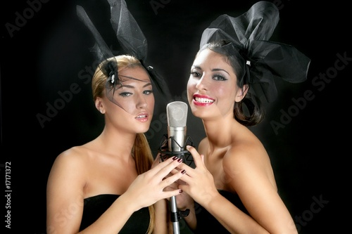 Beautiful women singing on a vintage microphone