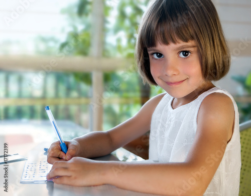 Elementary school pupil writing