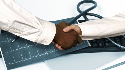Animation of doctors shaking hands against a hospital office