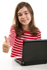 Girl using laptop isolated on white background
