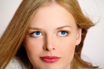 Charming blond girl close-up portrait