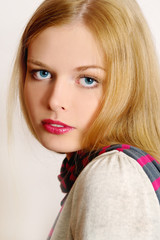 Charming blond girl close-up portrait, half-turn