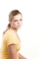 Headshot portrait of teenage girl in yellow blouse