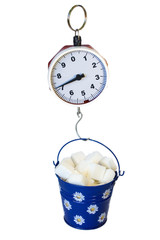 Weighing a bucket with sugar cubes