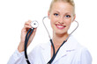 Happy female doctor in hospital gown with stethoscope
