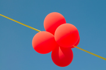 Amusing balls and yellow ribbon in the sky.