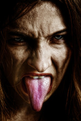 Evil scary sinister woman with tongue out