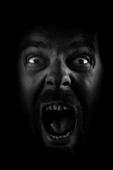 Scream of spooky scared crazy man