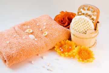 beauty items with aromatherapy candles, towel, flowers.