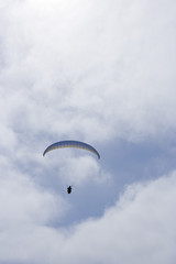 paraglider descending into the clouds
