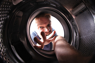 man in wash machine